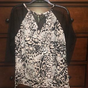 Women top size L, animal print with lace inserts.